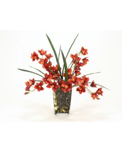 Waterlook® Rust Cymbidium Orchids with Foliage in Leopard-Spotted Glass Vase
