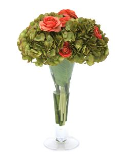 Green Hydrangeas and Coral Ranunculus in Trumpet Vase