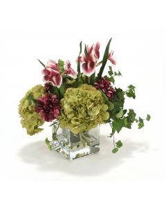 Waterlook® Plum Zinnias and Irises, Green Hydrangeas in Square Glass Vase