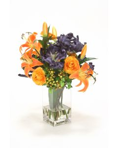 Waterlook® Orange Lilies and Ranunculus with Navy Tulips in Square Vase