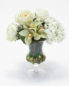 Waterlook® White Roses and Hydrangeas with Cymbidium Orchids in Clear Glass Urn