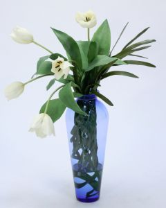 White Tulips Wrapped in Woven Blades in Tall Blue Vase