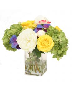 Mixed Spring Flowers with Hydrangeas, Pansies and Peonies in Glass Vase