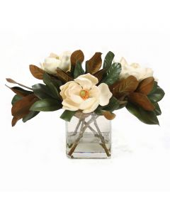 Magnolia Blooms with Magnolia Foliage in Rectangle Glass Vase