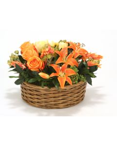 Yellow Tulips, Orange Lillies and Ranunculus Mix in Apple Basket