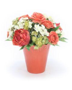 Ranunculas and Peonies in Coral Flower Pot Vase