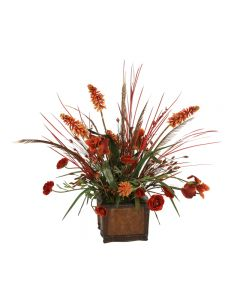 Rust Iris, Ranunculus and Red Hot Poker with Dried Grasses in Leather Chateau Planter
