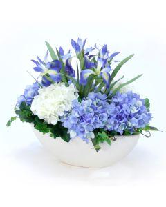 Blue Mix of Hydrangeas and Irises in Oval White Glazed Blowl