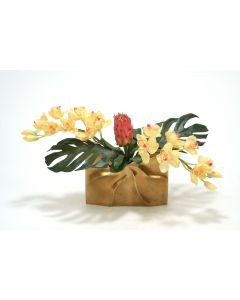 Tropical Mix of Champagne Burgundy Orchids and Protea in A Gold Ritz Vase