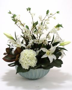 White Hydrangea, Casablanca Lily, and Cherry Blossoms in A Pool Blue Fluted Bowl