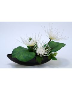 White Fuji Mums in A Black Oval Ceramic Bowl