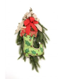 Fir Swag with A Green Holly Print Stocking and A Bow of Red and One of Burlap