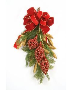 Cedar Swag with Gold Leaves Red Ornaments and A Red Bow with Gold Trim